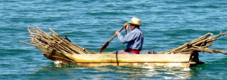 Lake Atitlan, Guatemala - Man hauling firewood