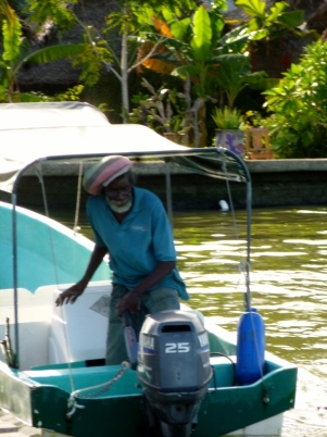 A water taxi driver