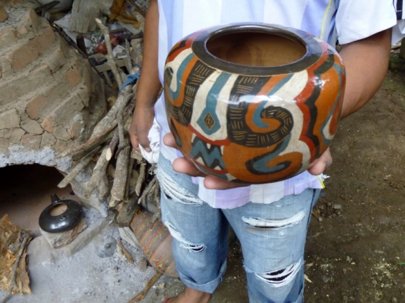 A fired and polished pot using natural pigments
