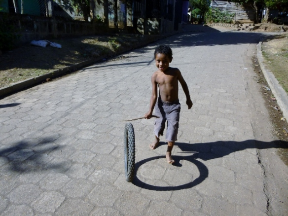 Boy with a stick & tire
