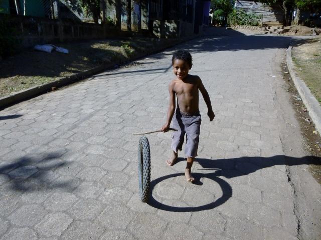 Boy with a stick & tire