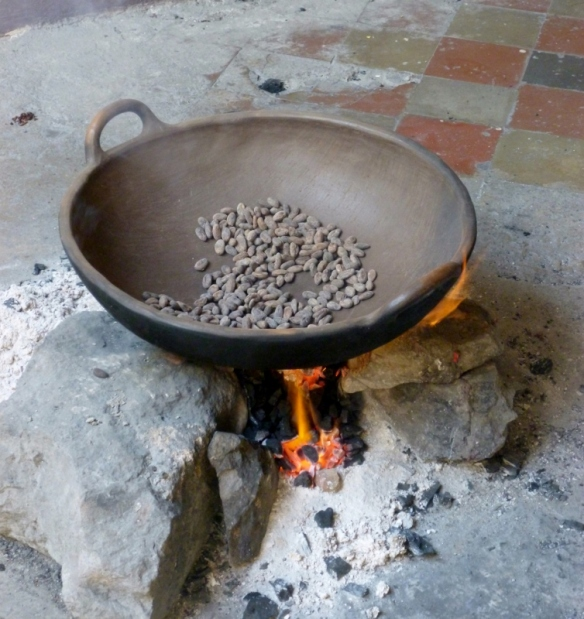 Roasting the beans in an ironwood cauldron