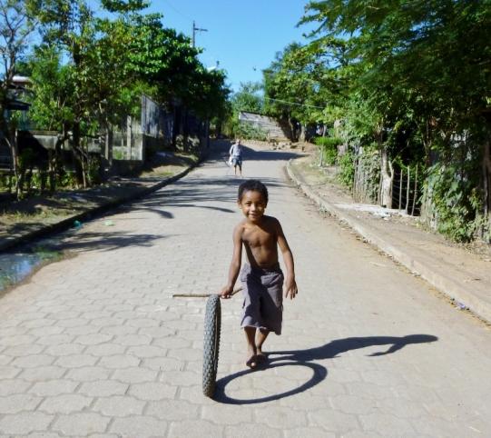 Simple games - a boy, a tire, a stick - Granada,Nicaragua