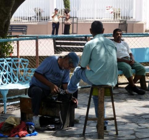 Shoe shines at Parque Central - Sebaco,Nicaragua