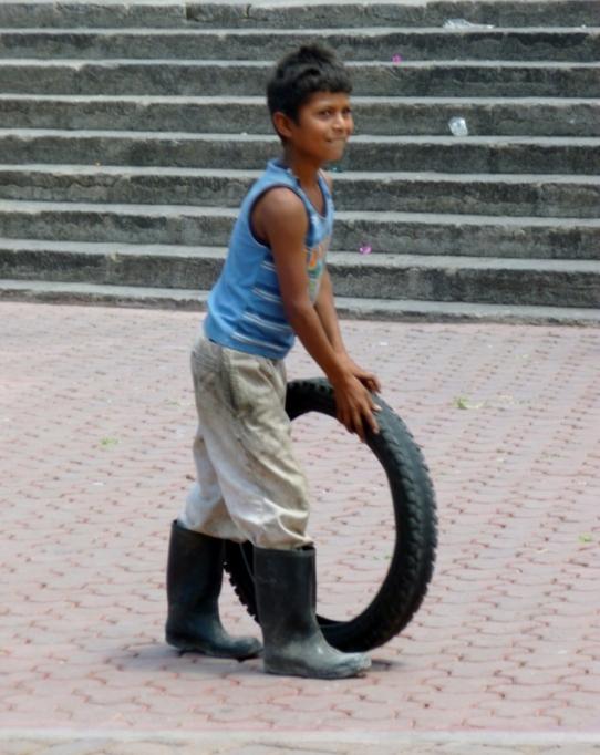 Young boy with a tire - Matagalpa,Nicaragua