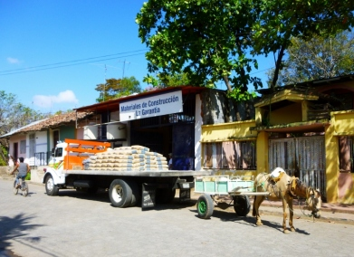 Delivery in many modes - bike, horse or truck - Granada