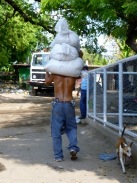 carrying bags of rice or beans,Granada, Nicaragua