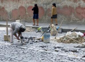 Repairing cobblestone streets - Antigua
