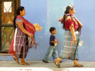 In step -Street vendors and boy - Antigua,Guatemala