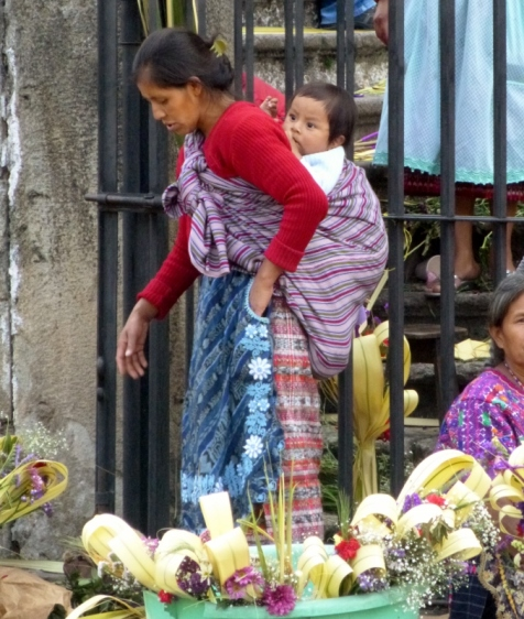 Mother and child at La Cathedral early Palm Sunday - Antigua,Guatemala