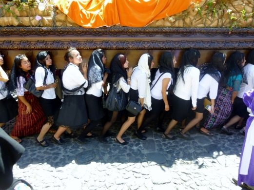 women carry an Andus and statues for Good Friday procession - Antigua