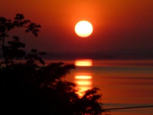 Sunset over Lago Peten - El Remate
