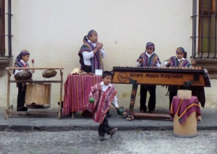 Street performers and a marimba band - Antigua,Guatemala