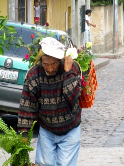 man carrying flowers - Santa Ana - Antigua,Guatemala
