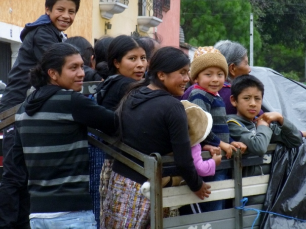 A truck bed full of riders - Antigua,Guatemala