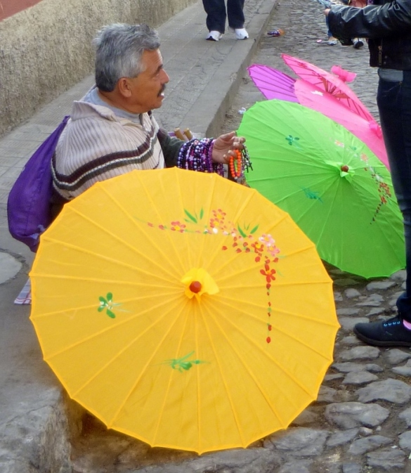 man selling parasols - Antigua
