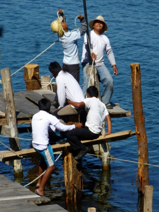 Building a dock - driving pile in at Lake Atitilan,Guatemala
