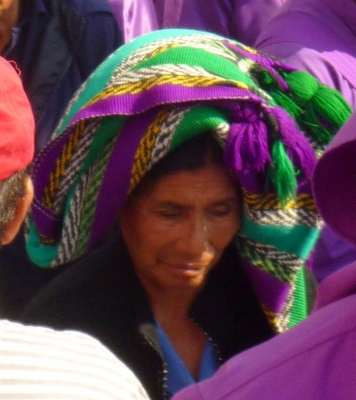 Mayan woman in the crowd at a Lent procession - Antigua,Guatemala