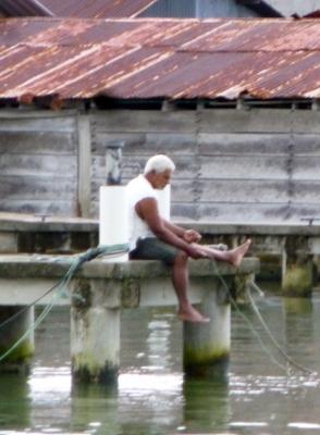 A fisherman with hand line - Livingston,Guatemala