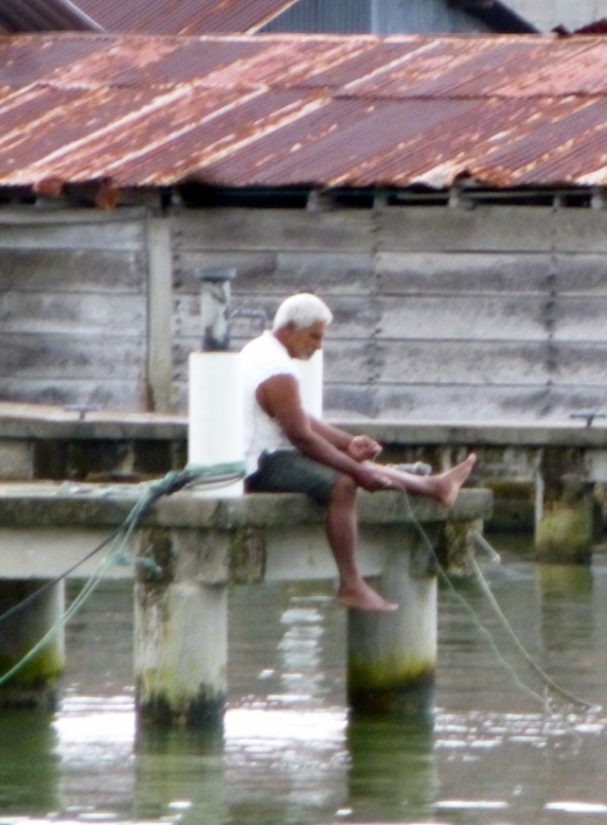 A fisherman with hand line - Livingston,Guatemala