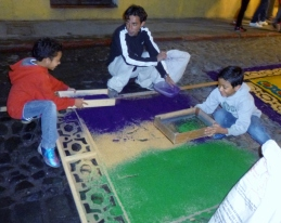 a father and sons making an alfombra - Antigua