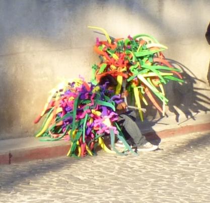 young vendors hiding behind their goods - Antigua