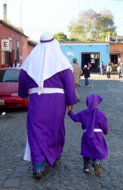 a father and son in Lenten purple - Antigua