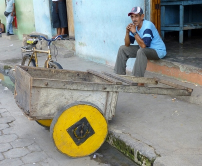 Man and machine with colorful wheels - Granada, Nicaragua