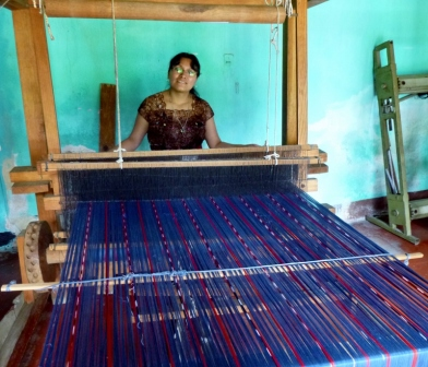weaving on a loom - San Juan La Laguna,Guatemala