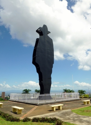 Sandino silhouette against Managua skyline