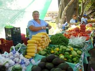 smiling woman at the farmers market - Atenas,Costa Rica