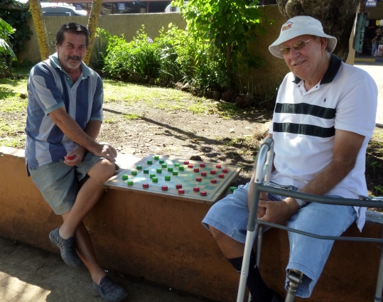 A friendly game of checkers downtown at the park in Atenas,Costa Rica