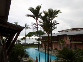 lipstick palms in foreground at Mar Arenas condos in Jaco