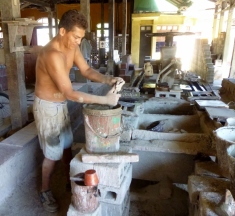 stirring paint at the tile factory - Granada