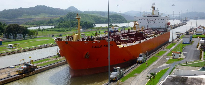 Mules guiding a ship through the Panama Canal