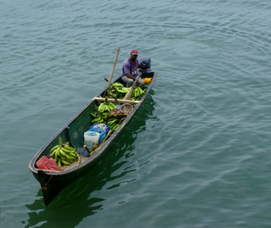 traditional wooden boat loaded with bananas