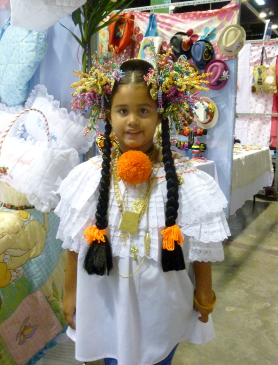 girl wearing traditional dress and hair ornaments - Panama City, Panama