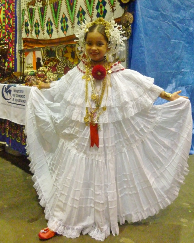 girl wearing traditional dress and hair ornaments - Panama City