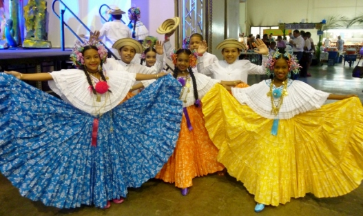 Boys and girls showing off their traditional Panamanian clothing and hats - Panama City