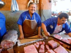 a happy fish vendor at the Tarqui market, Manta
