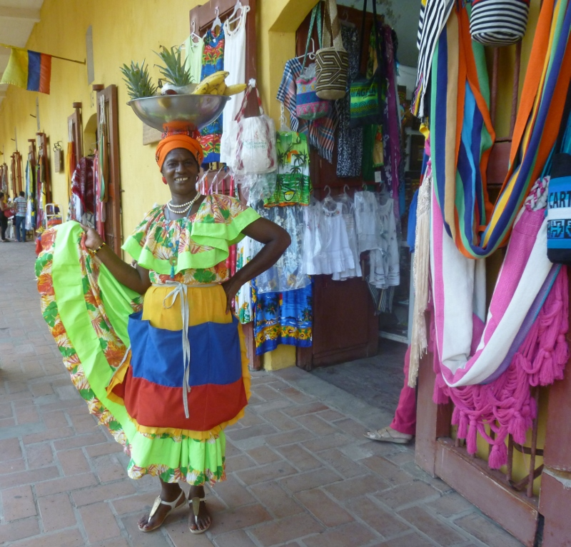 street vendor in traditional Colombian dress