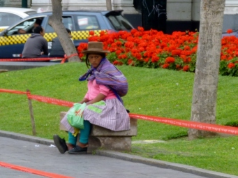 a vendor in traditional Peruvian dress - Lima, Peru