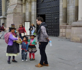 Peruvian vendor (and children) selling wares - Lima
