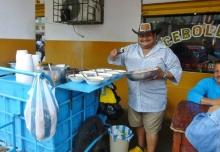 serving up the meals - enceballado soup - Manta, Ecuador