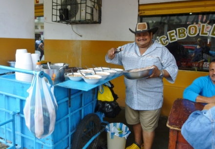 serving up the meals - enceballado soup - Manta, Ecuador