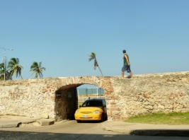 old wall, taxi and pedestrian in Cartagena