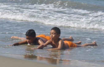 brothers in orange, Cartagena beach