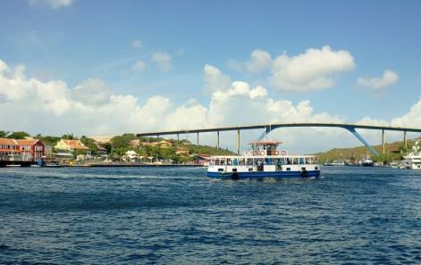 ferry in front of Queen Juliana Bridge