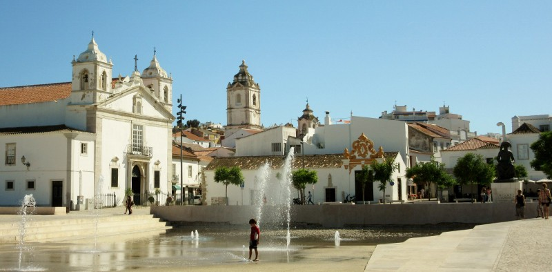 plaza fountains & boy with church of Santa Maria and Santo Antonio