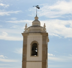 blowing the trumpet, Albufeira, Portugal